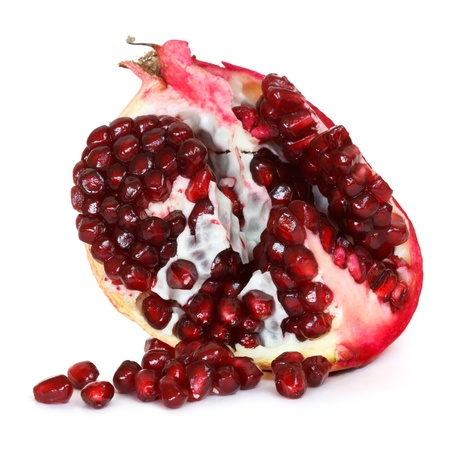 pomegranate with loose seeds over white background Stock Photo - 13328752