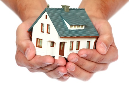 buy house: miniature house in hands