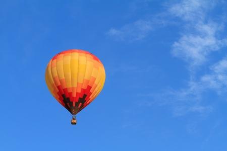 hot air balloon over blue sky photo