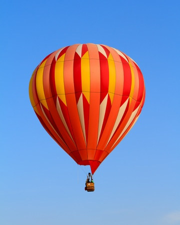 to inflate: hot air balloon over blue sky
