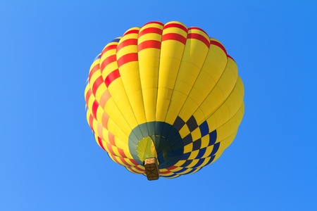 hot air balloon over blue sky photo