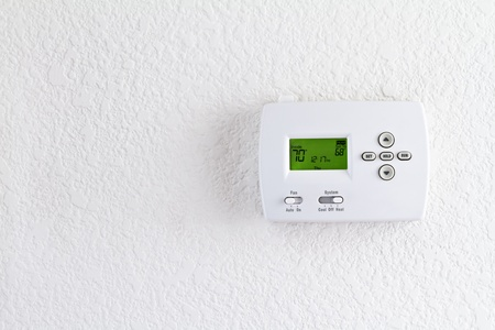 thermostat: digital thermostat on white wall