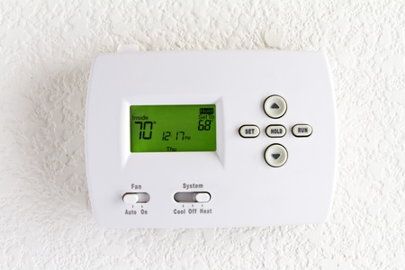 digital thermostat on white wall photo