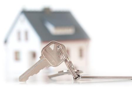 toetsen met huis op achtergrond Stockfoto
