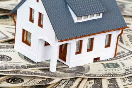 realty residence: house and money Stock Photo