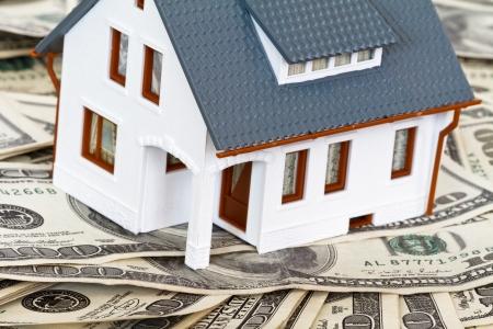 huis en geld Stockfoto