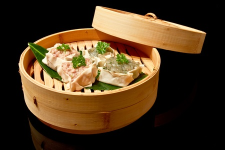bast basket: Japanese Cuisine - Pork Dumplings in Bast Basket Stock Photo
