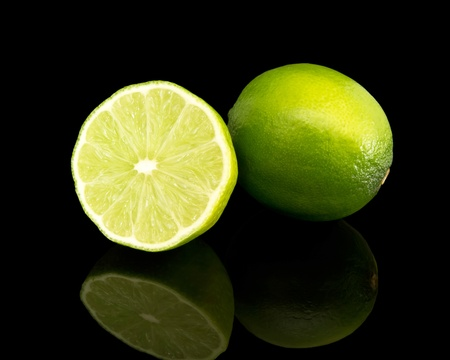 lime green background: lime isolated on black