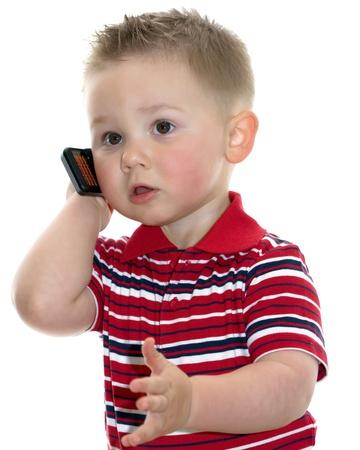 niÑos hablando: chico lindo con el teléfono sobre fondo blanco