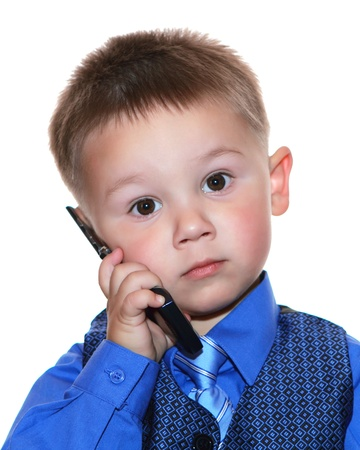 babies: cute business man with phone over white background Stock Photo
