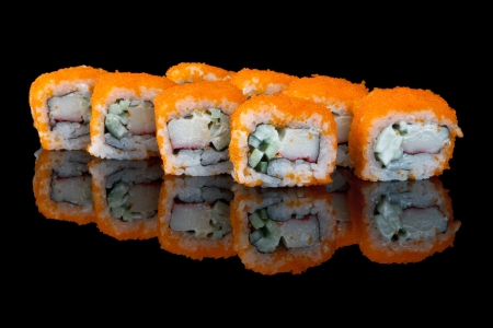 california roll: sushi with flying fish eggs, glass reflection
