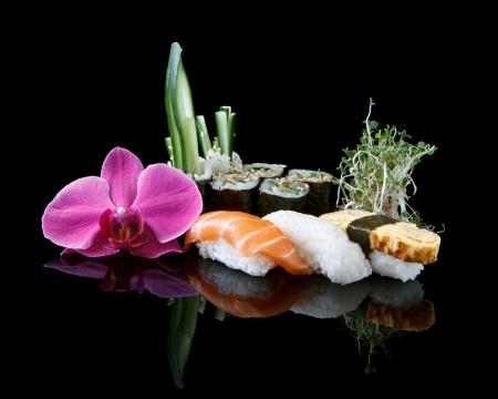 sushi over black background