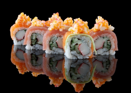 california roll: sushi over black background
