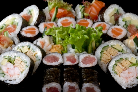 sushi set over black background