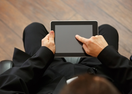 working at office: business man with digital tablet
