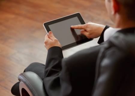 touchpad: business man with digital tablet