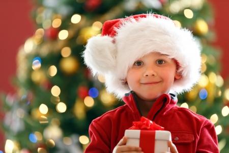 happy christmas: boy with Christmas gift