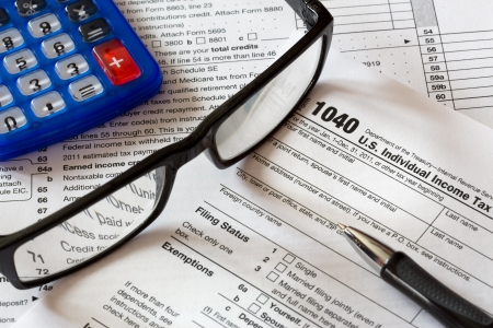 tax form with calculator and pen Stock Photo
