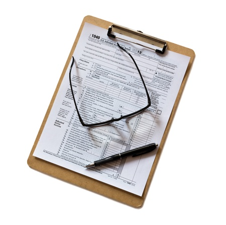 taxable: tax form on clipboard Stock Photo