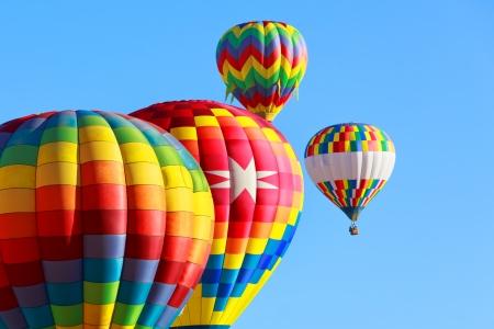 air: hot air balloons over blue sky