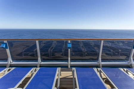 Lounge chairs on deck of luxury cruise ship photo