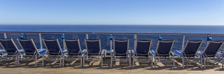 deck chairs: Lounge chairs on deck of luxury cruise ship Stock Photo