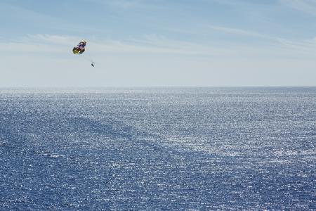parasailing: Parasailing at sea Stock Photo