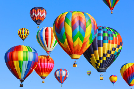 Colorful hot air balloons over blue sky Banque d'images