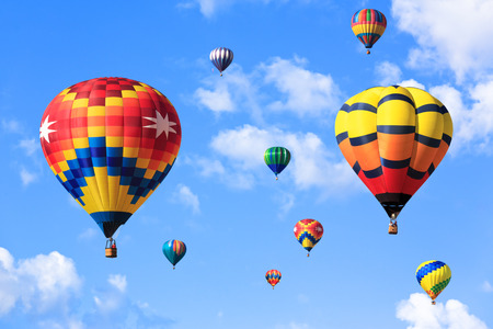 Colorful hot air balloons over blue sky photo