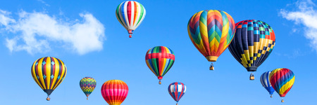 Colorful hot air balloons over blue sky Stock Photo