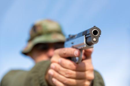 Man with gun photo