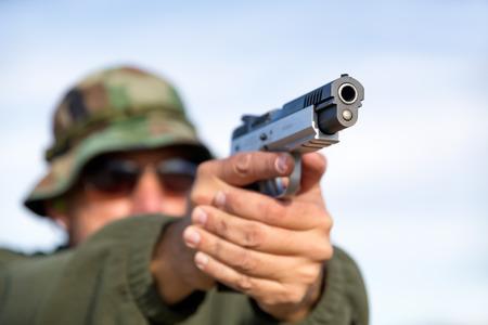 gunshot: Gun in hands