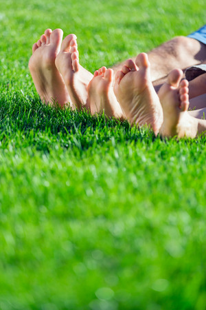 relaxation: Family relaxing on the grass Stock Photo