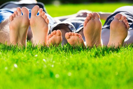 Family relaxing on the grass Reklamní fotografie