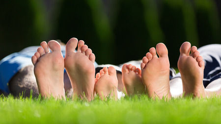 Family relaxing on the grass photo