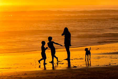 Family relaxing on the beach photo