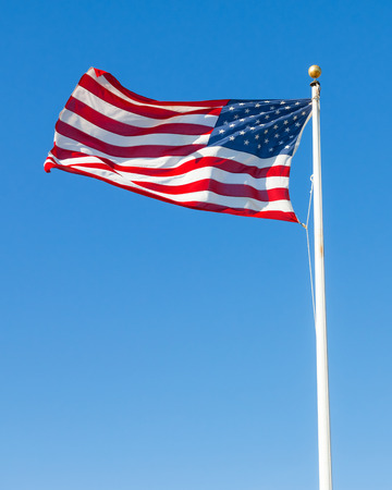 american flags: American flag against clear blue sky