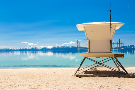 sierra snow: Lake beach with lifeguard station Stock Photo