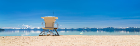 sand harbor: Beach patrol station on the lake with view on snowy Sierra Nevada mountains. Stock Photo
