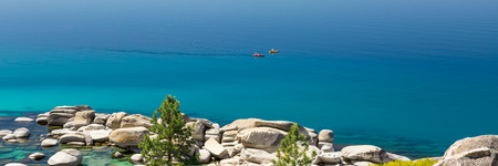 tahoe: Photograph of two kayaks on calm Lake Tahoe