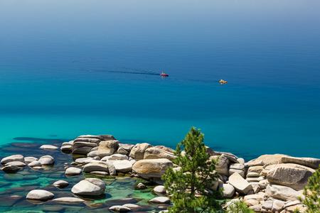lake tahoe: Photograph of two kayaks on calm Lake Tahoe