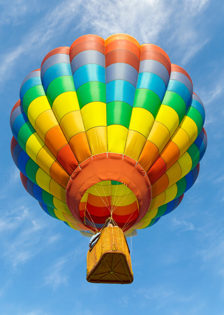 Colorful hot air balloon flying up.