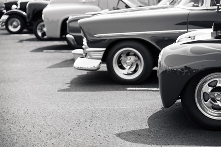in a row: Classic cars parked in a row Stock Photo