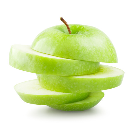sliced: Stack of sliced green apple isolated on white