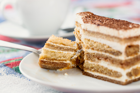 cookies and cream: Tiramisu cake with cup of coffee Stock Photo