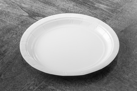 picnic food: Paper plate on wooden table Stock Photo