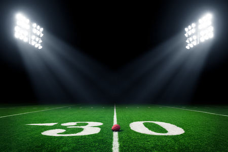 American football field at night with stadium lights Archivio Fotografico