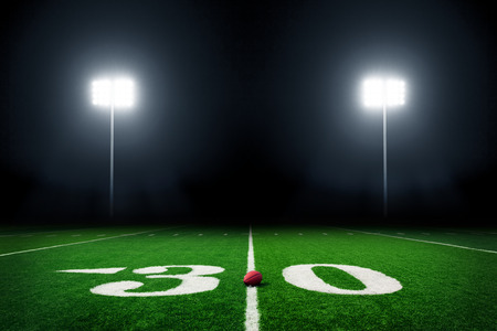 campo calcio: American football field at night with stadium lights Archivio Fotografico