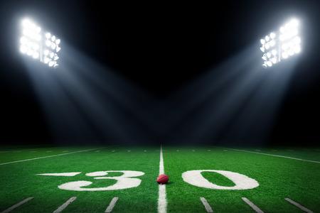 terrain football: terrain de football américain dans la nuit avec des lumières du stade