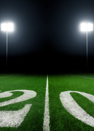 green field: American football field at night with stadium lights Stock Photo